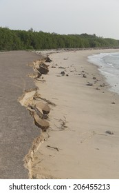 landslide along the beach by water and wind