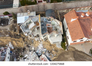 Landslide caused by rains of hurricane destroyed expensive cottages and houses. Destroyed house, cottage, large cracks, chips, slabs. Broken asphalt shifted landslide after earthquake. View from drone
