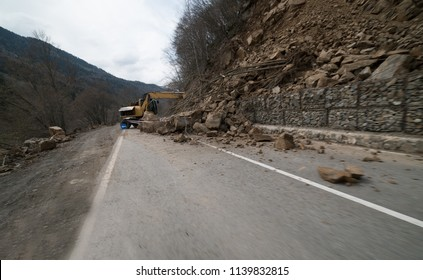landslide caused by torrential rains of hurricane CHRISTIE. Broken road asphalt cracked, and came down with landslide. Destroyed mountains ground. earthquake