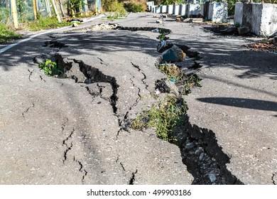 Landslide caused by torrential rains of Hurricane CHRISTIE. Broken road asphalt cracked and shifted by landslide after earthquake. Destruction of roads large cracks chips from shift of asphalt on road