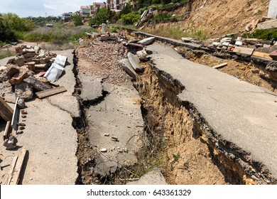landslide caused by torrential rains of hurricane CHRISTIE. Broken road asphalt cracked, and came down with landslide. Destroyed residential buildings of cottage town elite settlement. earthquake