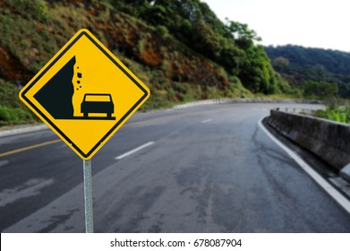 Landslide, Caution falling rocks Sign Yellow traffic sign on the road background