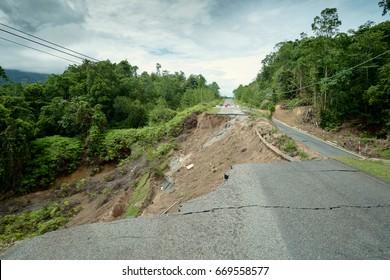 Landslide Collapsed Asphalt Road, Cracked and Broken.