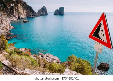 Landslide danger sign and seaview from Via Krupp - paved footpath on the island of Capri, Italy.