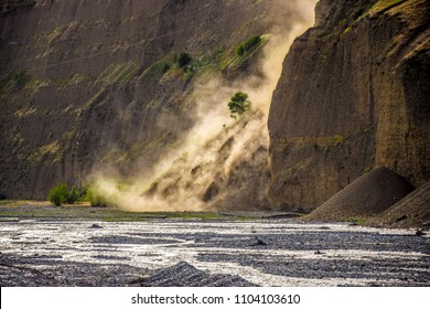 Landslide next to a mountain river bed