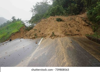 landslide at rural road in Sabah Malaysia Borneo due to heavy rain.