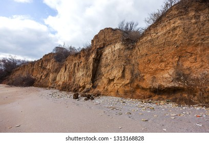 Landslide zone on Black Sea coast. Rock of sea rock shell. Zone of natural disasters during rainy season. Large masses of earth slip along slope of hill. Landslide - threat to life