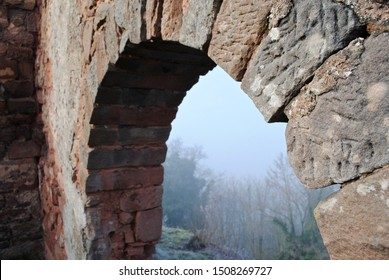 LANDSTUHL, GERMANY - 2014: Burg Nanstein (Nanstein Castle) in Landstuhl, Germany on a foggy, misty morning. It was built around 1162. A stone arch with view of the surrounding forest.