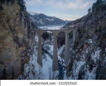 Landwasser Viaduct Switzerland Filisur Graubünden aerial view in Winter with mountains in background