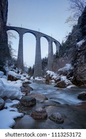 Landwasser Viaduct Switzerland Filisur Graubünden in Winter with creek in foreground