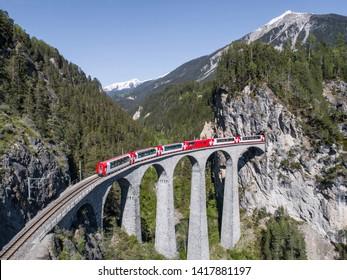 Landwasser viaduct, train of Rhaetian Railway.  Filisur, Canton of Grisons, Switzerland. May 2019