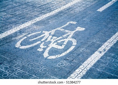 Lane for bicycles on a blue roadway.