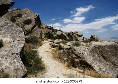 Lane in a Gobustan Natural park with beautiful stones and ancient neolithic rock paintings, Azerbaijan,near Baku