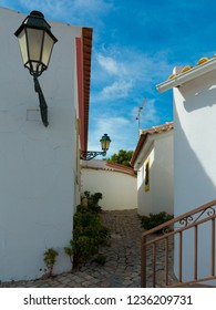 """lane leading uphill between houses in the small town """"Salir"""", Algarve, Portugal"""