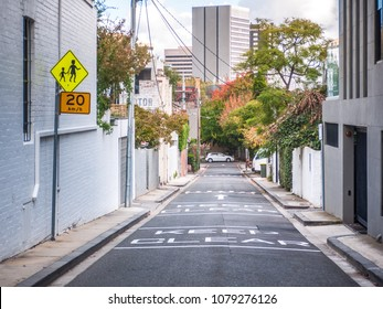 Laneway between suburban houses with speed limit sign on side. South Yarra, VIC Australia.