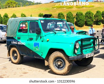 Lang Biang,  Lac Duong town / Jan 11, 2019. Photo of Jeep green car in Lang Biang on sunny day. Lang Biang is considered a specific tourist site with tourism forms of picnic exploring the nature.