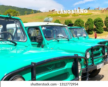 Lang Biang,  Lac Duong town / Jan 11, 2019. Photo of Jeep green cars in Lang Biang on sunny day. Lang Biang is considered a specific tourist site with tourism forms of picnic exploring the nature.
