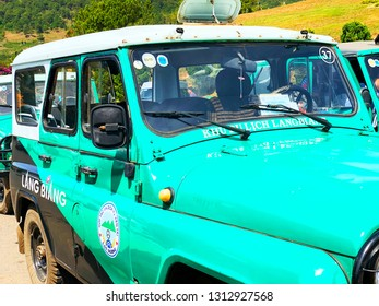 Lang Biang,  Lac Duong town / Jan 11, 2019. Close-up view of Jeep green car in Lang Biang on sunny day. Lang Biang is considered a specific tourist site with tourism forms of picnic exploring the natu