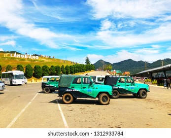 Lang Biang,  Lac Duong town / Jan 11, 2019. Over view of Jeep green cars in Lang Biang on sunny day. Lang Biang is considered a specific tourist site with tourism forms of picnic exploring the nature.