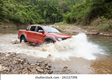 Lang Son, Viet Nam - Nov 4, 2014: Ford Ranger Wildtrak crossing river in Vietnam