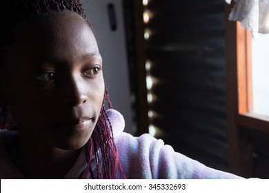 LANGA TOWNSHIP, SOUTH AFRICA - JULY 12, 2015 - A young girl poses for a photograph at her home in Langa, South Africa, a township located on the outskirts of Cape Town.