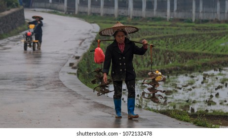 Langde, China - March 27, 2018: Miao farmers going back home in Langde Miao village, Guizhou province, China