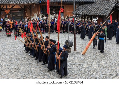 Langde, China - March 27, 2018: People of the Miao ethnic minority performing a traditional dance in Langde Miao Nationality  village, Guizhou province, China