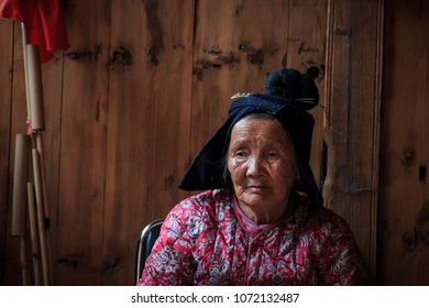 Langde, China - March 27, 2018: Old Miao woman in Langde Miao village, Guizhou province, China