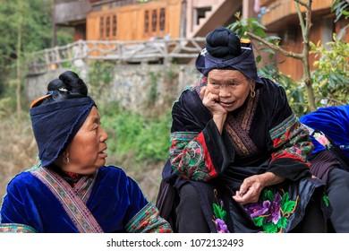 Langde, China - March 27, 2018: Miao women chatting in Langde Miao village, Guizhou province, China