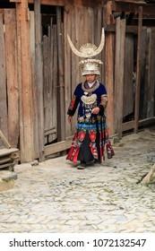 Langde, China - March 27, 2018: Miao woman wearing the traditional Miao attire in Langde Miao village, Guizhou province, China
