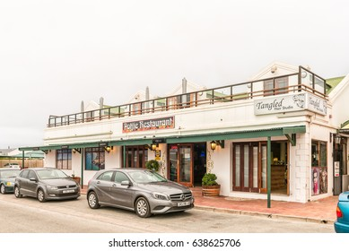 LANGEBAAN, SOUTH AFRICA - MARCH 31, 2017: A restaurant and a hair salon in Langebaan, a town on the Atlantic Coast of the Western Cape Province