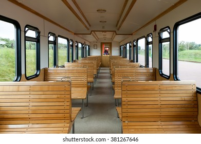 LANGEOOG, GERMANY - AUG 31, 2004: Rows of wooden seats in old passenger car of traditional train on the East Frisian island Langeoog, Lower Saxony