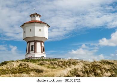 LANGEOOG, GERMANY - AUG 31, 2004: Water tower in the dunes of the East Frisian island Langeoog, Lower Saxony, Germany