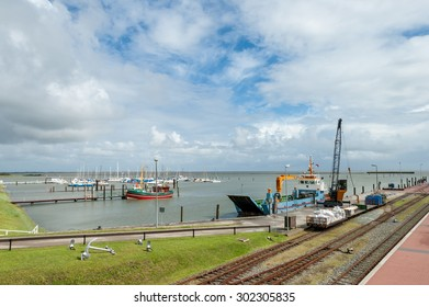 LANGEOOG, GERMANY - AUGUST 31, 2004: Yachts and supply ship in the harbour of the East Frisian island Langeoog, Lower Saxony, Germany