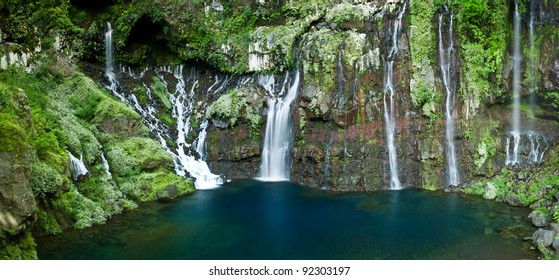 The Langevin Waterfall at Reunion Island and a pool of blue water.