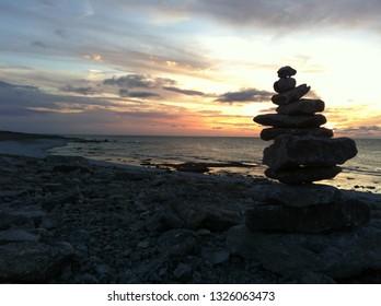 Langhammars, Faro, Gotland, Sweden - August 20, 2012: Stack of limestones at beach in sunset
