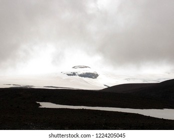 Langjokull glacier: white snow and black rock mountain. Contrasts of Icelandic Nature. Popular tourist destination in West Iceland, Europe