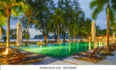 Langkawi Island, Malaysia - February 10th 2017: An evening view of the outdoor swimming pool next to Tanjung Rhu beach overlooking the islands of Langkawi.