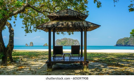 Langkawi Island, Malaysia - February 10th 2017: A beach hut underneath a shady tree near Tanjung Rhu beach in Langkawi Island.