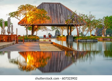 Langkawi Island, Malaysia - February 10th 2017: An evening view of the beach hut with pool reflection next to Tanjung Rhu beach overlooking the islands of Langkawi.