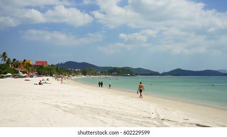 Langkawi Island, Malaysia - February 11th 2017: White sandy Cenang beach in Langkawi Island, Malaysia.