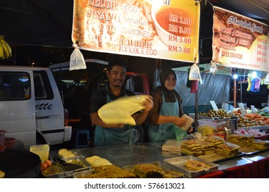 Langkawi island, Malaysia - January, 2012: man cooking roti chanai in the night market