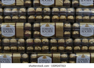 LANGKAWI ISLAND/MALAYSIA-AUGUST 3rd 2015:Selective focus of stack of Ferrero Rocher chocolate in plastic box Ferrero Rocher is a chocolate sweet made by Italian Ferrero Spa.
