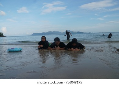 Langkawi, Kedah circa 23 October 2017. Tourist playing sand at the beach.