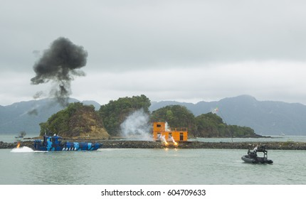 LANGKAWI, MALAYSIA - 20 MARCH 2017: Malaysian special forces storm a mock terrorist group with explosions in conjunction with LIMA Expo