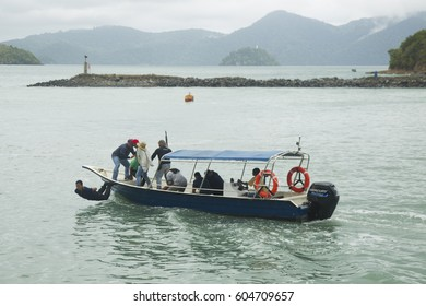 LANGKAWI, MALAYSIA - 20 MARCH 2017: Mock terrorist display throwing a hostage overboard in conjunction with LIMA Expo