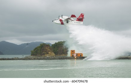 LANGKAWI, MALAYSIA - 20 MARCH 2017: Bombardier aircraft puts out a mock fire in conjunction with LIMA Expo