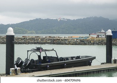 LANGKAWI, MALAYSIA - 20 MARCH 2017: Bombardier aircraft approaches a mock terrorist attack in conjunction with LIMA Expo