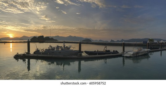 LANGKAWI, MALAYSIA - 22 MARCH 2017: Wide angle picture of various military and naval boats docked at jetty at sunrise at LIMA Expo