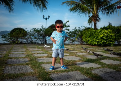 Langkawi, Malaysia - February 23, 2019: Chinese boy with sunglasses.